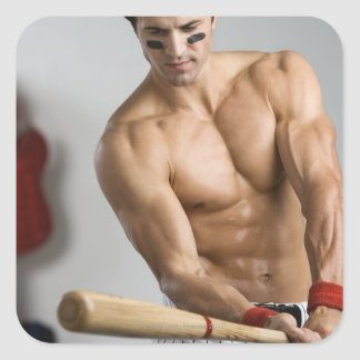 Baseball player with bare chest warming up with square sticker