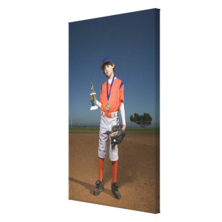 Baseball player with trophy and medal canvas print