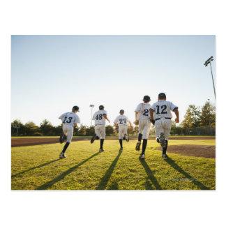 Baseball players (10-11) running on baseball postcard