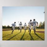 Baseball players (10-11) running on baseball poster