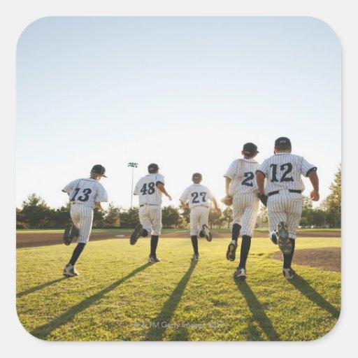 Baseball players (10-11) running on baseball square sticker