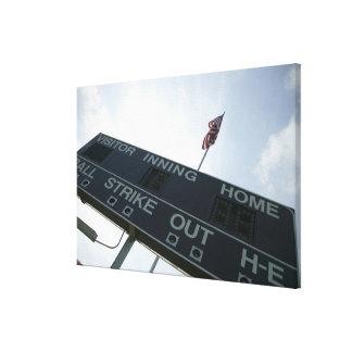 Baseball scoreboard with American flag Canvas Print