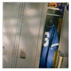 Baseball uniform and equipment in locker ceramic tile