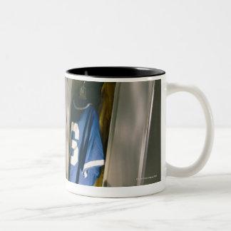 Baseball uniform and equipment in locker Two-Tone coffee mug