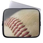 Baseball with impact mark. computer sleeves