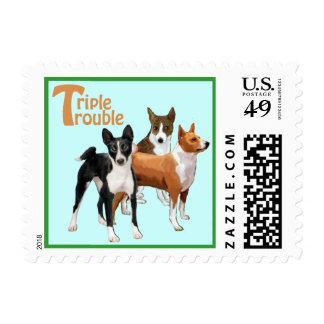 "Basenjo ""triple trouble"" postage stamp"