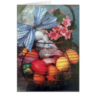 BASKET OF COLORED EGGS AND AN EASTER WISH CARD