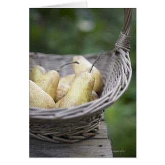 Basket of freshly picked pears. card