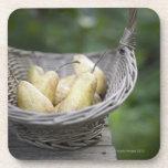 Basket of freshly picked pears. drink coaster