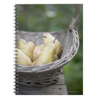 Basket of freshly picked pears spiral notebook