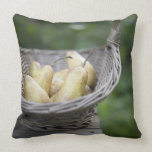 Basket of freshly picked pears throw pillow