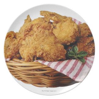 Basket of fried chicken dinner plate