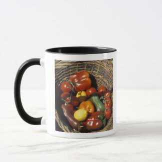Basket of fruits and vegetables on the place mug