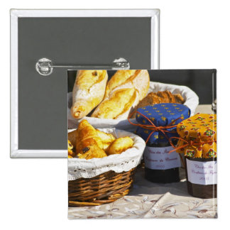 Basket with croissants and chocolate breads. pins
