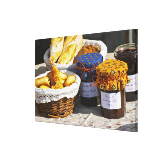 Basket with croissants and chocolate breads. gallery wrapped canvas