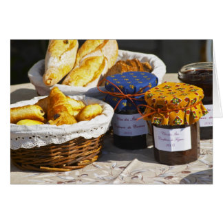 Basket with croissants and chocolate breads. greeting card
