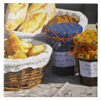 Basket with croissants and chocolate breads. ceramic tile