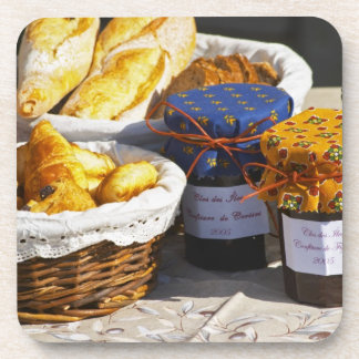Basket with croissants and chocolate breads. coaster