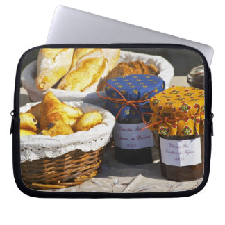 Basket with croissants and chocolate breads. laptop computer sleeve