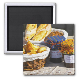 Basket with croissants and chocolate breads. fridge magnets