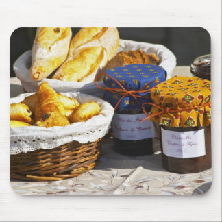 Basket with croissants and chocolate breads. mouse pad
