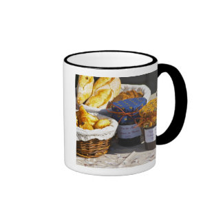 Basket with croissants and chocolate breads. mug