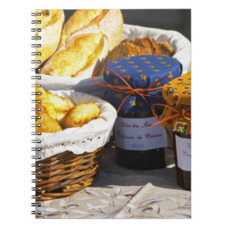 Basket with croissants and chocolate breads. note books