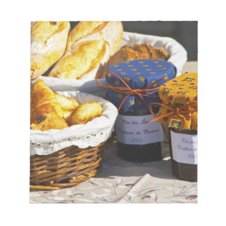 Basket with croissants and chocolate breads. memo pad