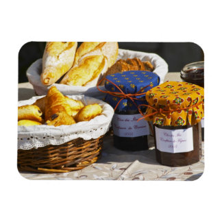 Basket with croissants and chocolate breads. flexible magnet
