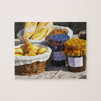 Basket with croissants and chocolate breads. jigsaw puzzle