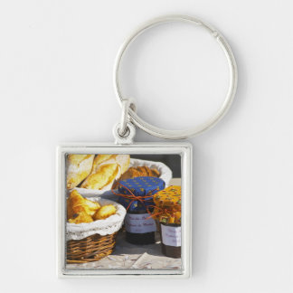 Basket with croissants and chocolate breads. Silver-Colored square keychain