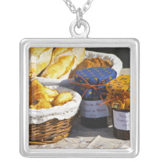 Basket with croissants and chocolate breads. silver plated necklace