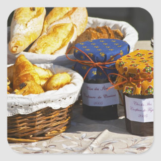 Basket with croissants and chocolate breads. square sticker