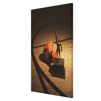Basketball and trophy on basketball court, canvas print