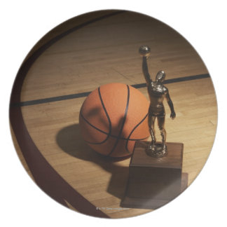 Basketball and trophy on basketball court, melamine plate