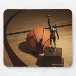 Basketball and trophy on basketball court, mouse pad