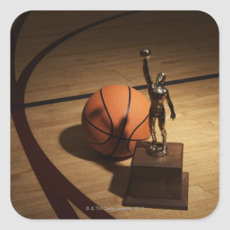 Basketball and trophy on basketball court, square sticker