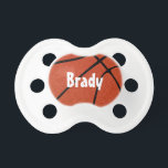 """Basketball Custom Baby Name Pacifier<br><div class=""""desc"""">Basketball Custom Baby Name Pacifier: Create a customized basketball pacifier by typing any text (numbers or letters) in the text box. These make awesome gift ideas for the youngest basketball fans! Check out our shop - Custom Sports Gear - for lots of other unique basketball gifts and accessories!</div>"""