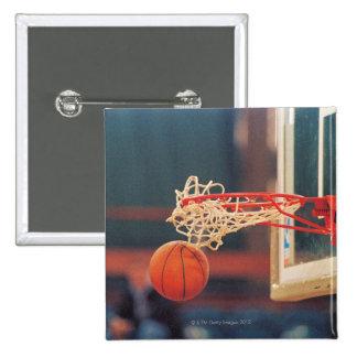 Basketball dropping through hoop button