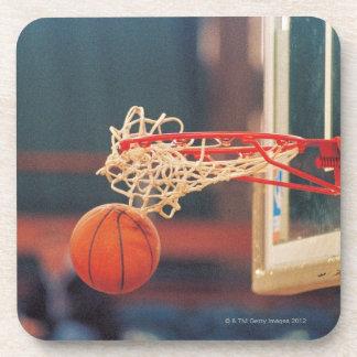 Basketball dropping through hoop drink coaster