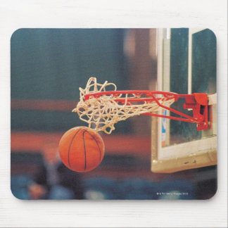 Basketball dropping through hoop mouse pad