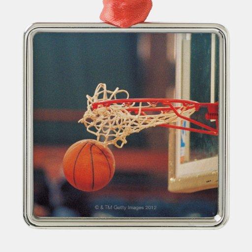Basketball dropping through hoop christmas tree ornament