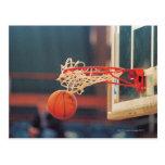 Basketball dropping through hoop postcard