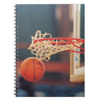 Basketball dropping through hoop spiral notebook