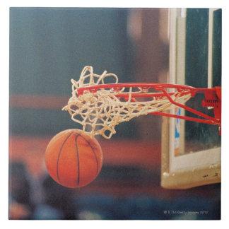 Basketball dropping through hoop tile