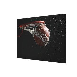Basketball going through hoop 2 canvas prints