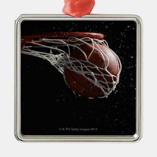 Basketball going through hoop 2 metal ornament