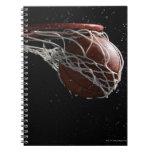 Basketball going through hoop 2 spiral notebooks
