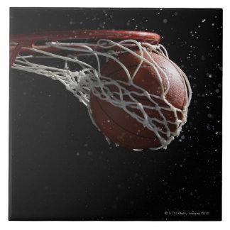 Basketball going through hoop 2 tile