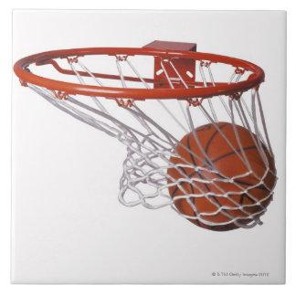 Basketball going through hoop ceramic tile